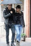 Justin Theroux Helps Shield Jennifer Aniston From the Rain