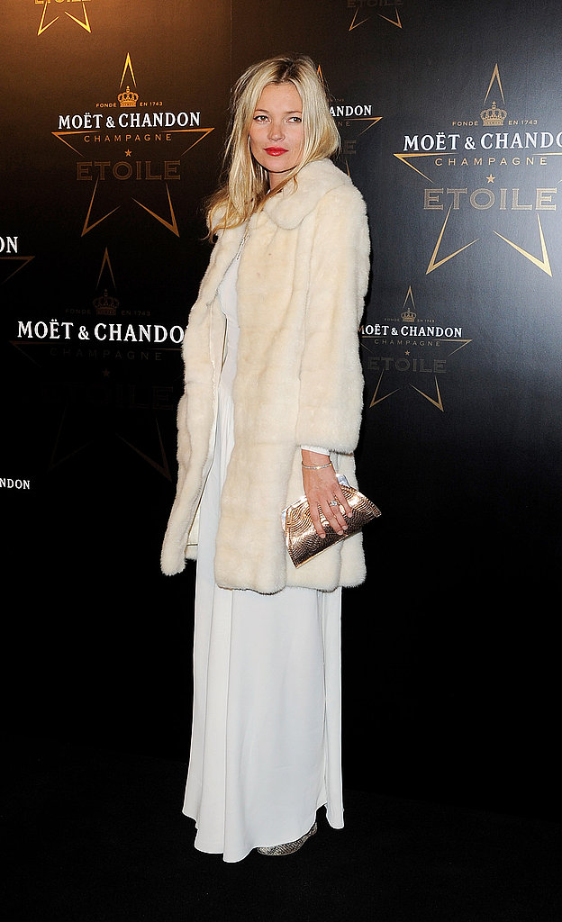 Kate Moss looked glamorous in a white gown and fur topper at the Moet & Chandon Etoile Awards and Gala.