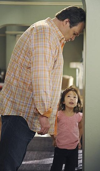 Eric Stonestreet as Cam and Aubrey Anderson-Emmons as Lily on Modern Family. Photo copyright 2011 ABC, Inc.