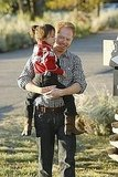 Jesse Tyler Ferguson as Mitchell and Aubrey Anderson-Emmons as Lily on Modern Family. Photo copyright 2011 ABC, Inc.