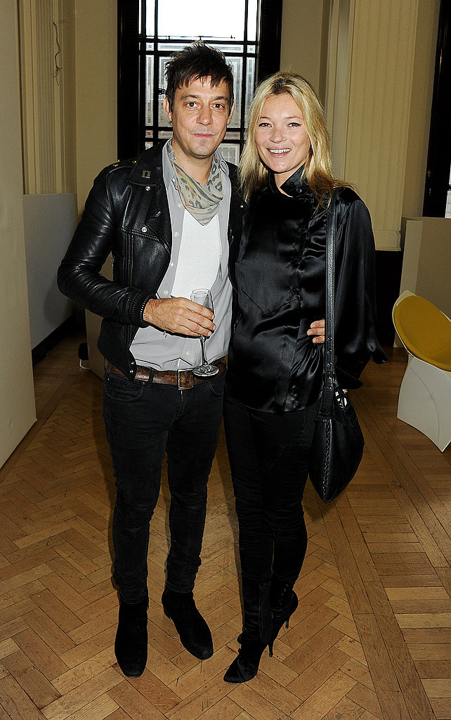 Kate Moss and Jamie Hince stuck close together while posing for photos after James Small's London Fashion Week show in September 2011.