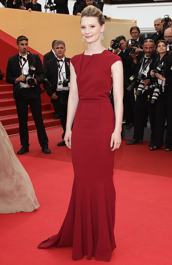 A bit of a departure for Mia in a sleek, bold red Roland Mouret for the Restless premiere in Cannes.