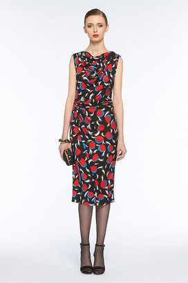 A conservative silhouette — below the knee and slim fit — get a feminine jolt from the print and pretty draped neck. Diane von Furstenberg Gabbie Dress (approx $351)