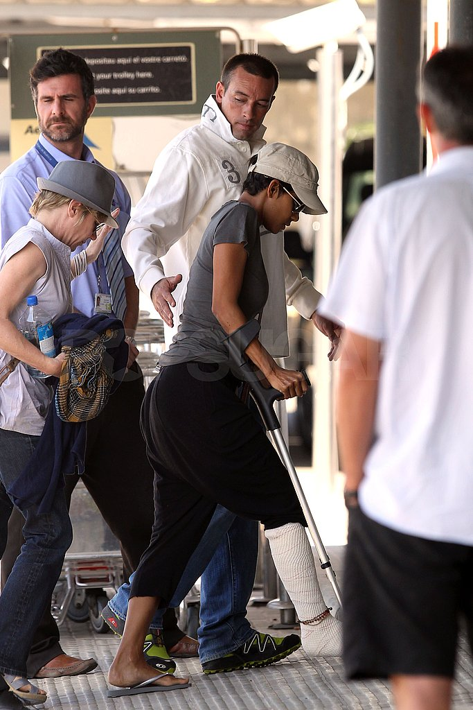 Halle Berry walked with the aid of crutches.