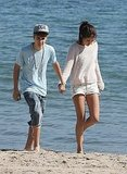 Selena and Justin walked along the shore in Malibu.