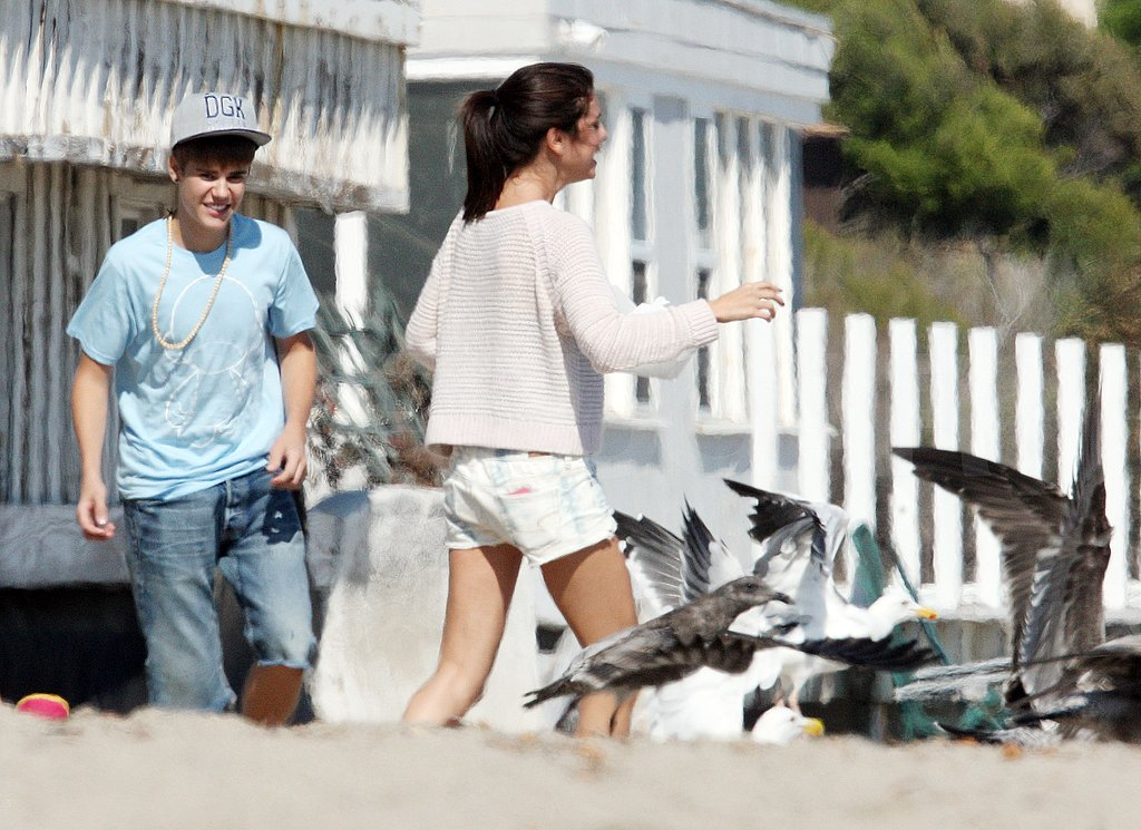 Selena and Justin joked around throwing bread at each other.