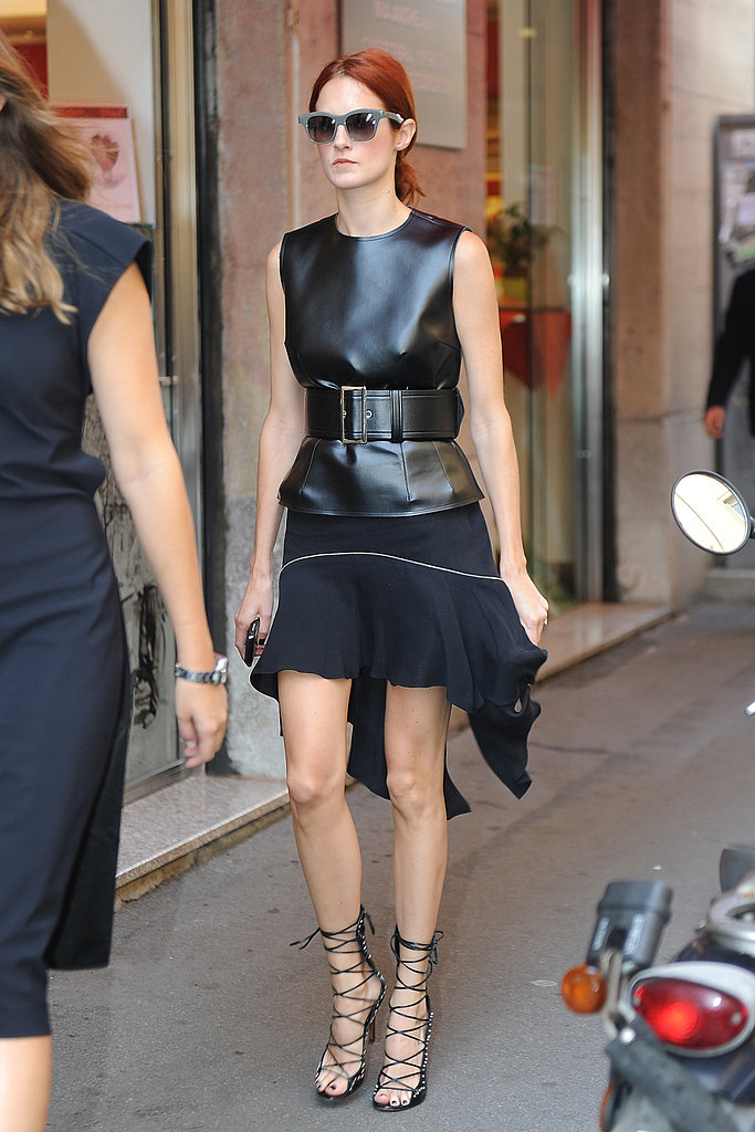 The always-polished Taylor Tomasi Hill in a striking leather top and lace-up sandals.
