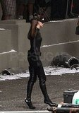 Anne Hathaway wore high heels along with her catsuit.