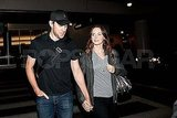 Emily Blunt and John Krasinski holding hands at LAX.