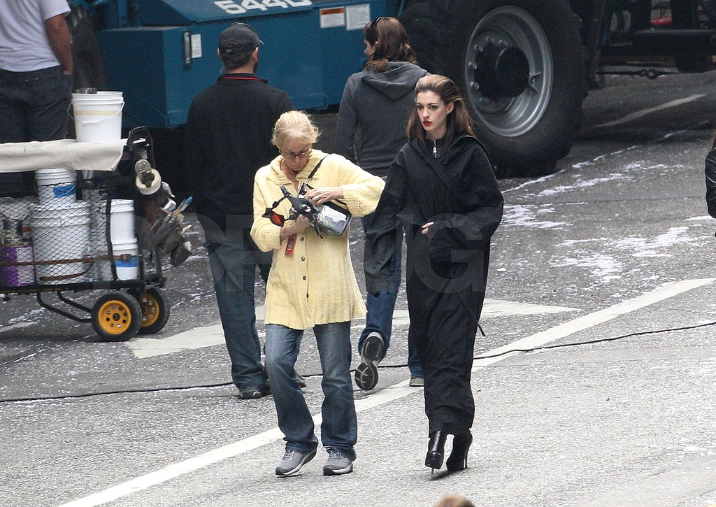 Anne Hathaway stepped out of her trailer in a black robe.