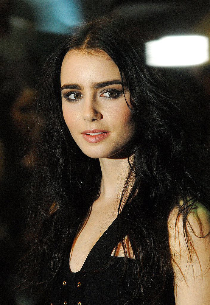 Lily Collins in black at the Abduction premiere in London.