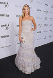 Heidi Klum wore a gorgeous Roberto Cavalli gown at the amfAR gala.
