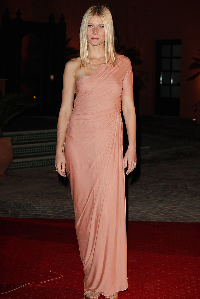 Sleek in an asymmetrical gown at an event in Morocco in 2009.