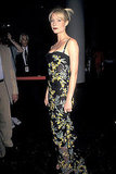 Going sultry with a dramatic pout and a curve-hugging Dolce & Gabbana bustier gown at the A Perfect Murder premiere in 1998.
