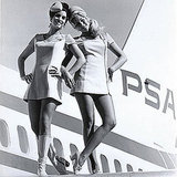 PSA gals hang out on the plane's wing.