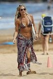 Molly Sims revealed enviable abs in her bikini.