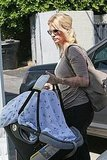 January Jones carried baby Xander's carrier.