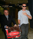 Hugh Jackman was all smiles at the Sydney airport.