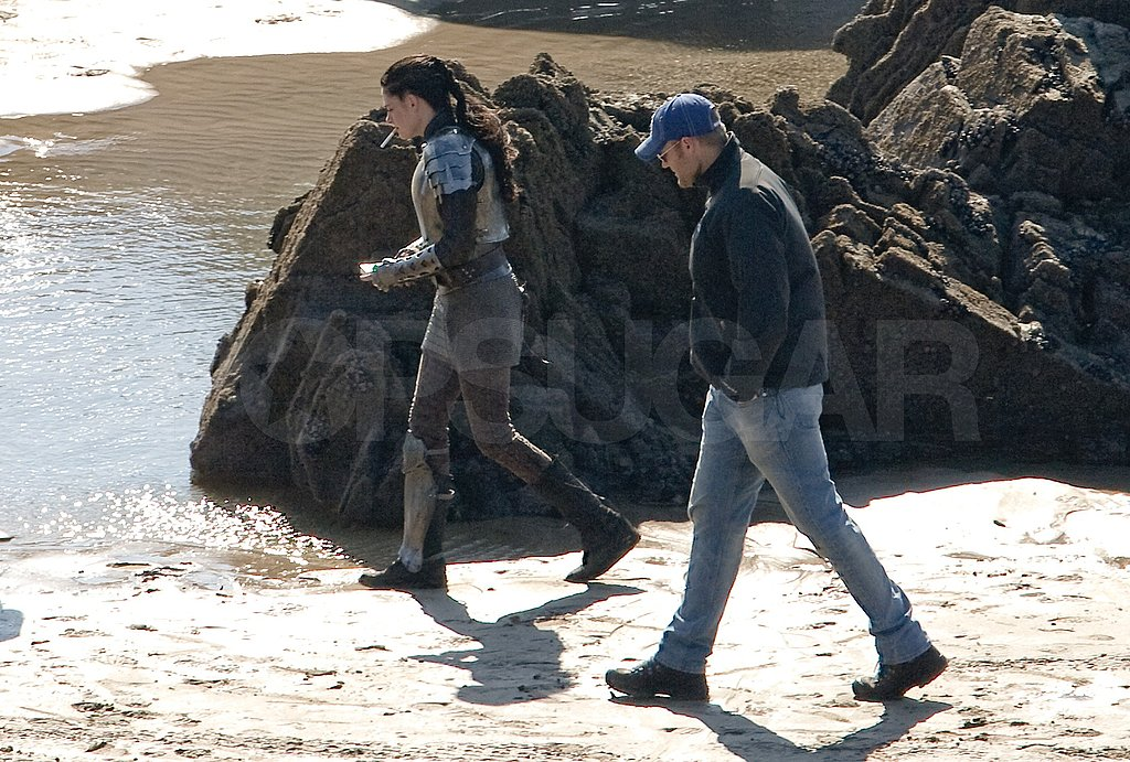 Kristen Stewart ran down to the shore in her armor.