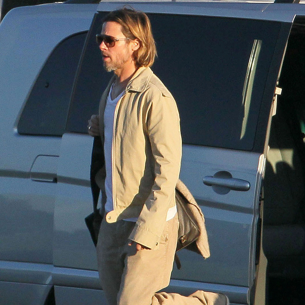 Brad Pitt hopped out of a van.