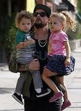 Joel Madden carries Harlow and Sparrow in LA.