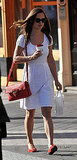 Pippa's red bag and flats add a striking contrast to her LWD.