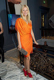 Gwyneth Paltrow complemented her orange Lanvin dress with a little color play, via a pair of crimson peep-toe booties.