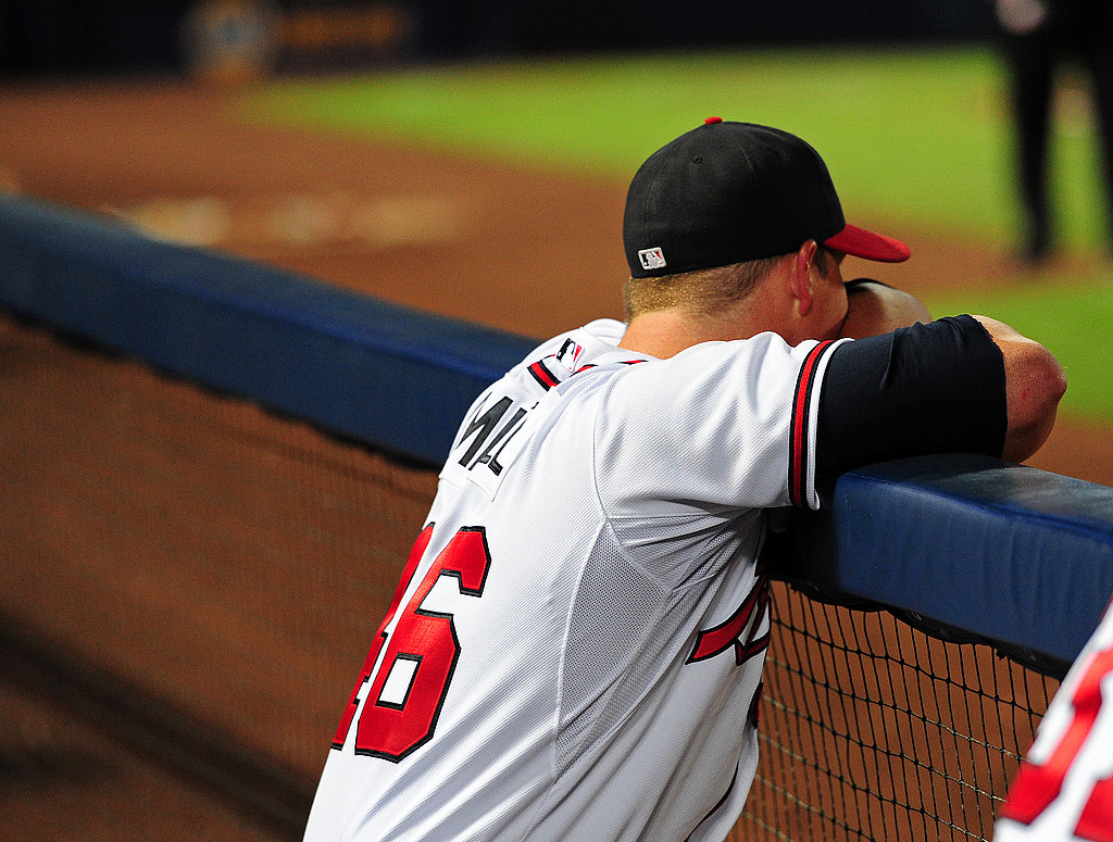 Craig Kimbrel of the Atlanta Braves stares out from the dugout after a disappointing end to the season.
