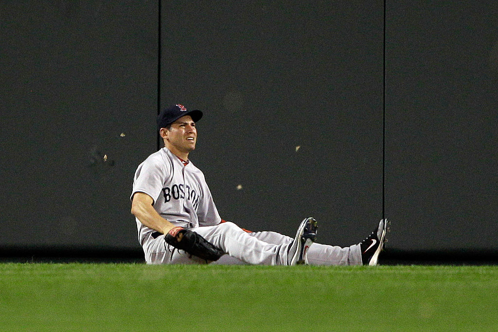 Centerfielder Jacoby Ellsbury of the Boston Red Sox sits on the grass after missing a ball earlier this week.