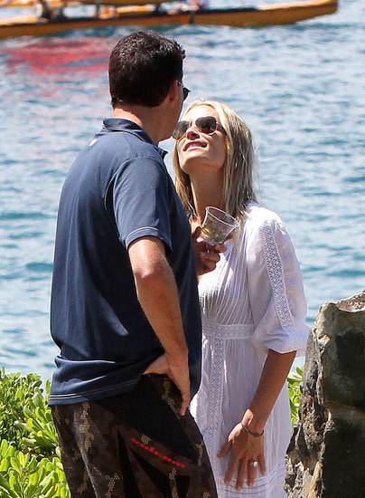 Molly Sims and husband Scott Stuber share a kiss.