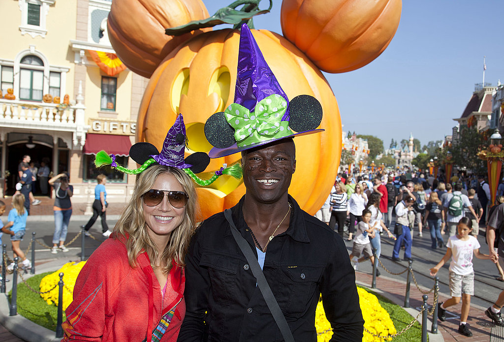 Heidi Klum and Seal wear hats at Disneyland.