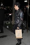 Justin Theroux with a to-go bag from Craft.