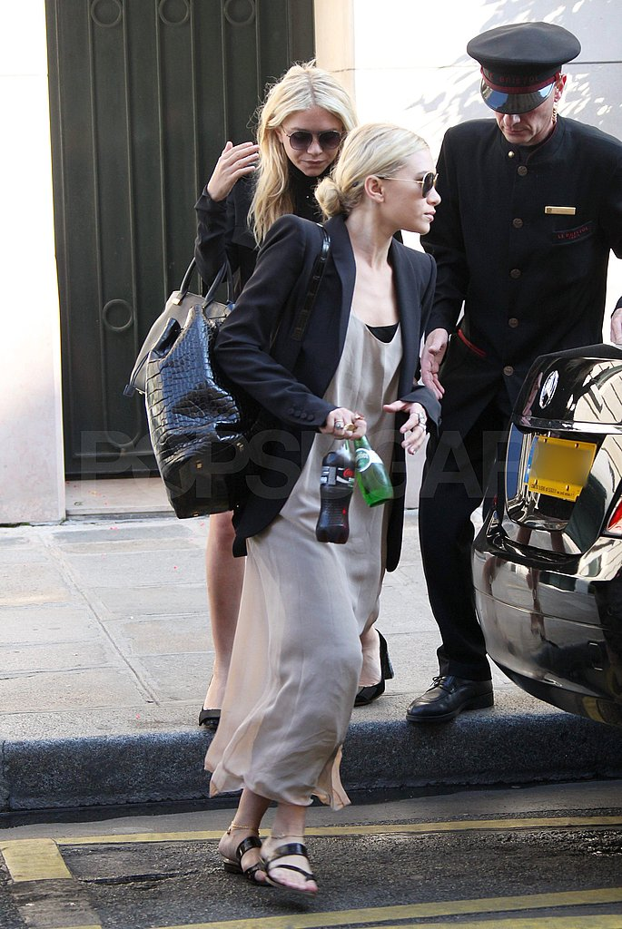 Ashley wore flat shoes around Paris.