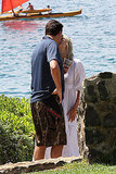 Molly Sims kissing husband Scott Stuber.