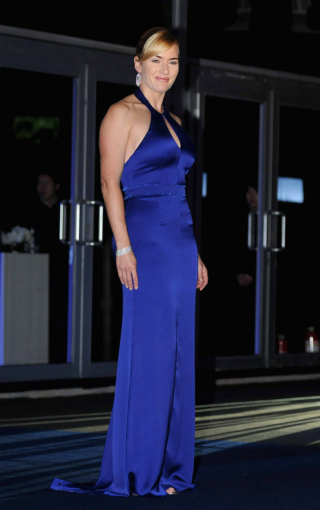 Kate Winslet wears a bright blue dress in Shanghai.