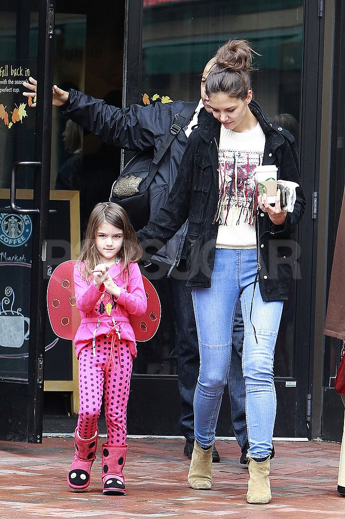 Katie Holmes reached for Suri's hand.