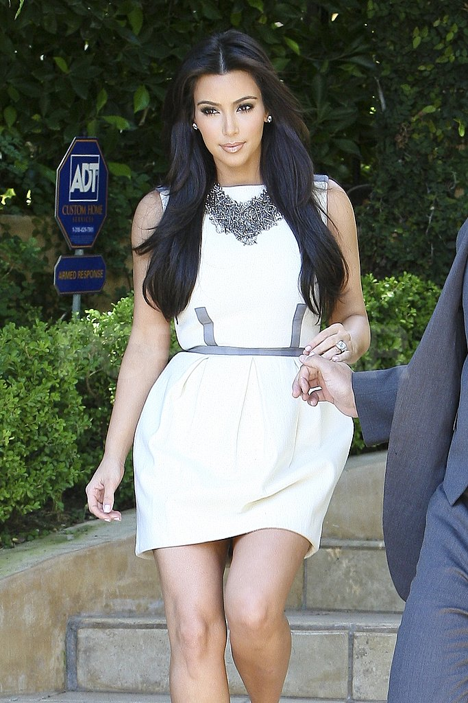 Kim Kardashian wore a white dress.