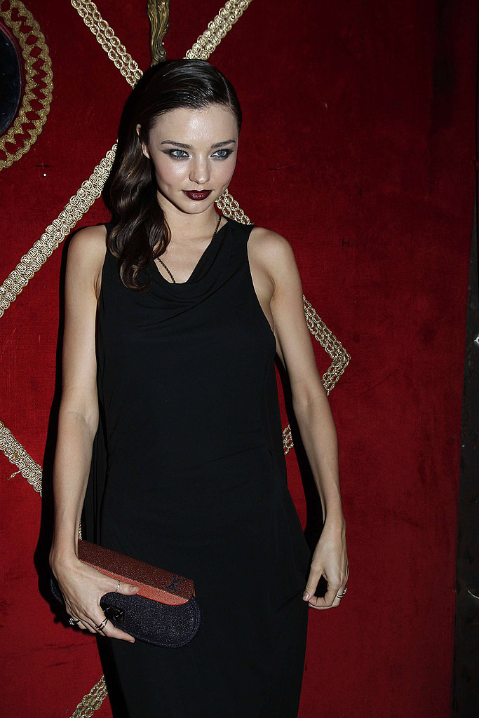 Miranda Kerr carried a small clutch to dinner in Paris.