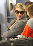 Jessica Simpson flashed a bright smile.