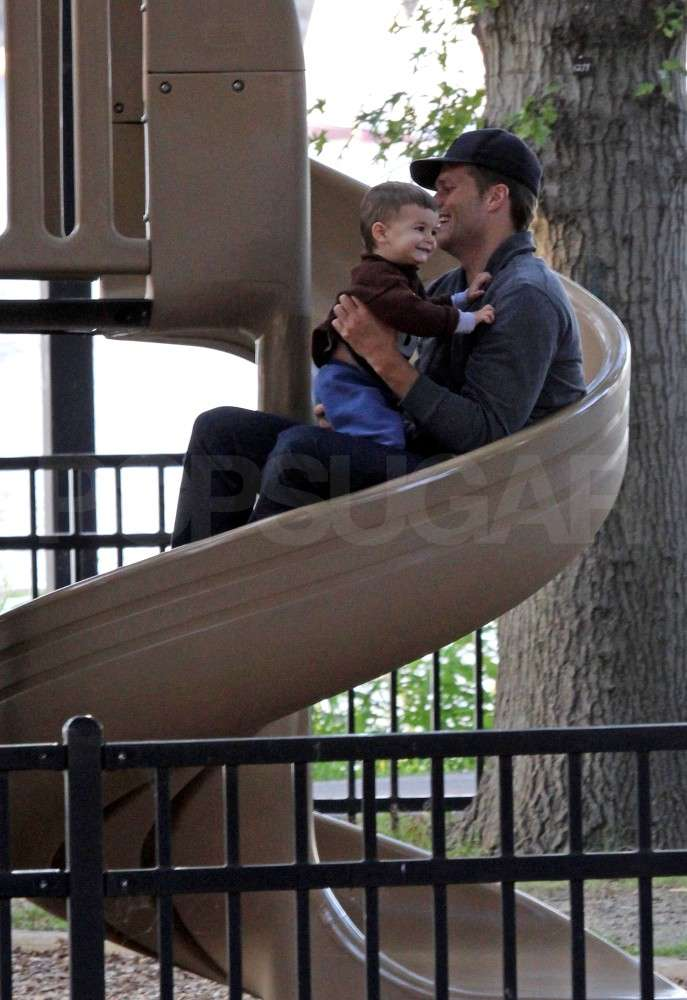 Benjamin Brady went down a slide on Tom Brady's lap.