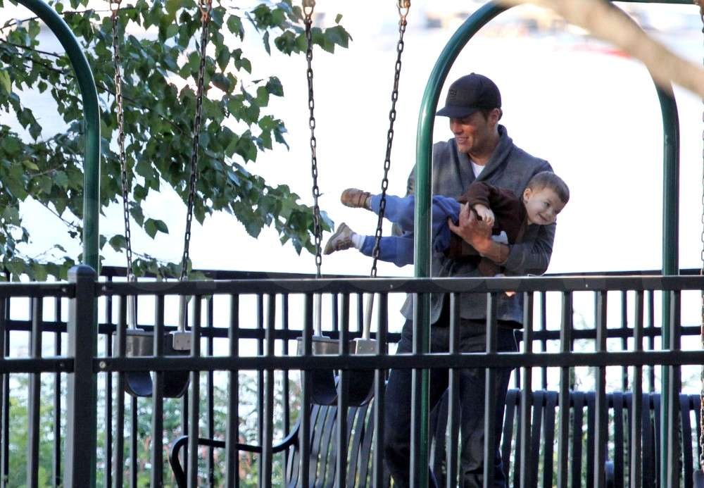 Tom Brady helped Benjamin Brady into a swing set in Boston.