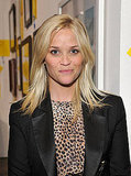 Reese Witherspoon in a leopard print dress and black blazer.