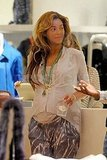 Pregnant Beyoncé shops at Intermix in NYC.