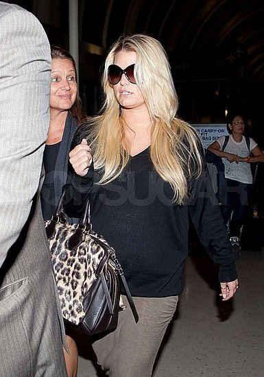 Jessica Simpson Sticks With Loose-Fitting Clothes as She Arrives Back at LAX