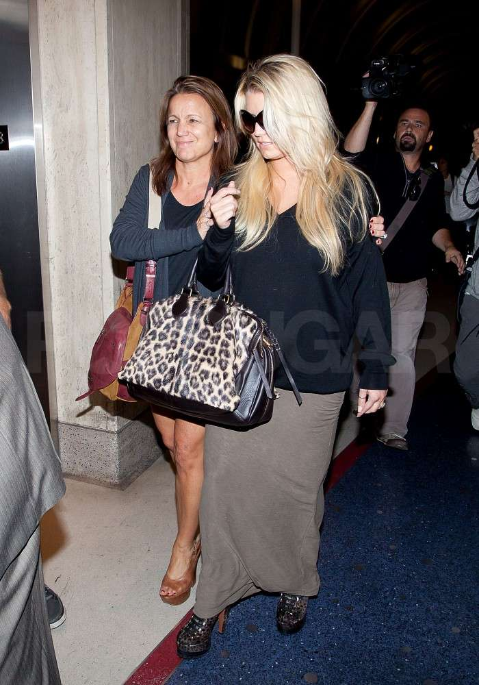 Jessica and Tina were arm in arm at LAX.