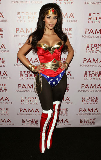 Wonder Woman Kim Kardashian went for a sexy superhero look, complete with thigh-high boots.