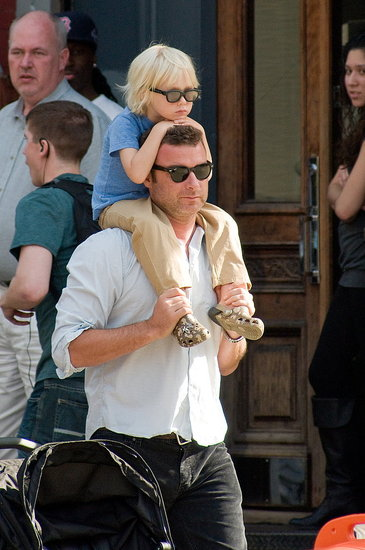 Sasha on Liev Schreiber's shoulders in NYC.