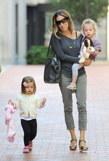 Sarah Jessica Parker carried Tabitha Broderick while Marion Broderick walked alongside them.