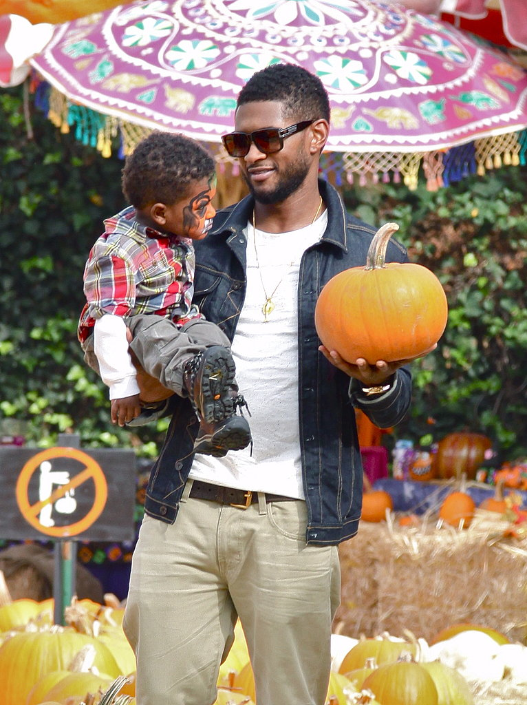 Usher held a face-painted Usher V while frolicking at a West Hollywood pumpkin patch in October 2010.