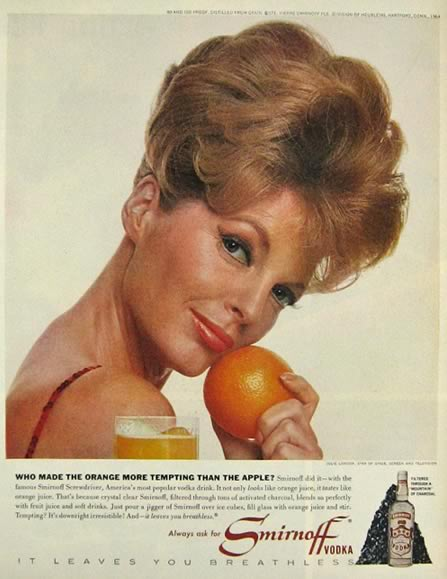 Singer Julie London makes the orange more tempting than the apple.